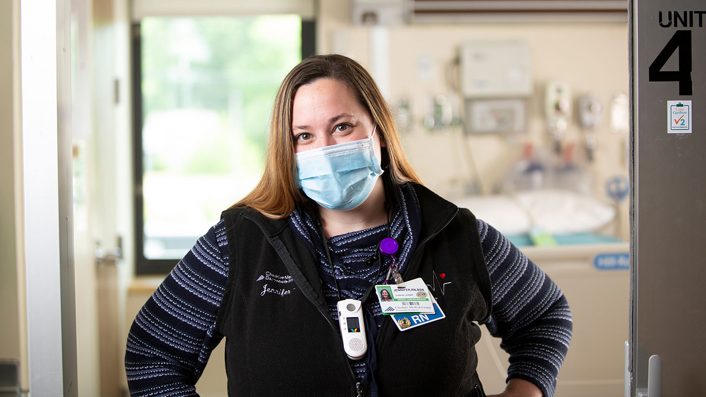 Healthcare provider at Cheshire Medical Center wearing a protective mask