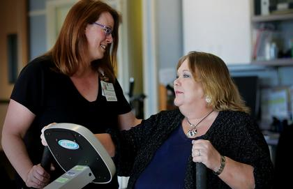 Claire Simpson shows off her strength as she reconnects with Occupational Therapist Cindi Zipoli.