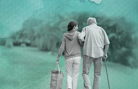 Caring for a loved one with dementia story - elderly man with younger woman.