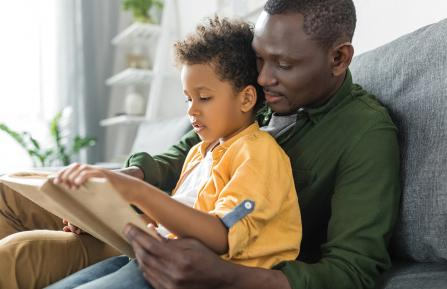 Man reading with child