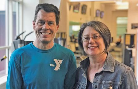 Nurse with YMCA official in gym