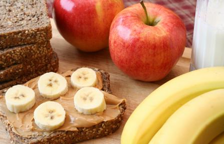 Peanut butter and banana sandwich with apples